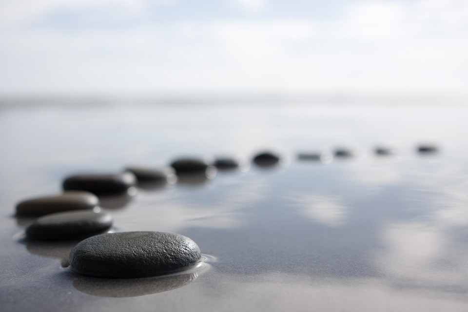 Stepping Stones fading into distance.  Words describing conditions which counselling can help with.